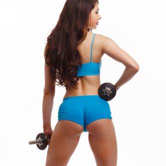 Confidentgym_Sports young woman Begeleiding bij het behalen van jouw doelstellingen